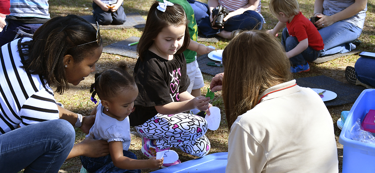 Children enjoying a nature program at Dix Park