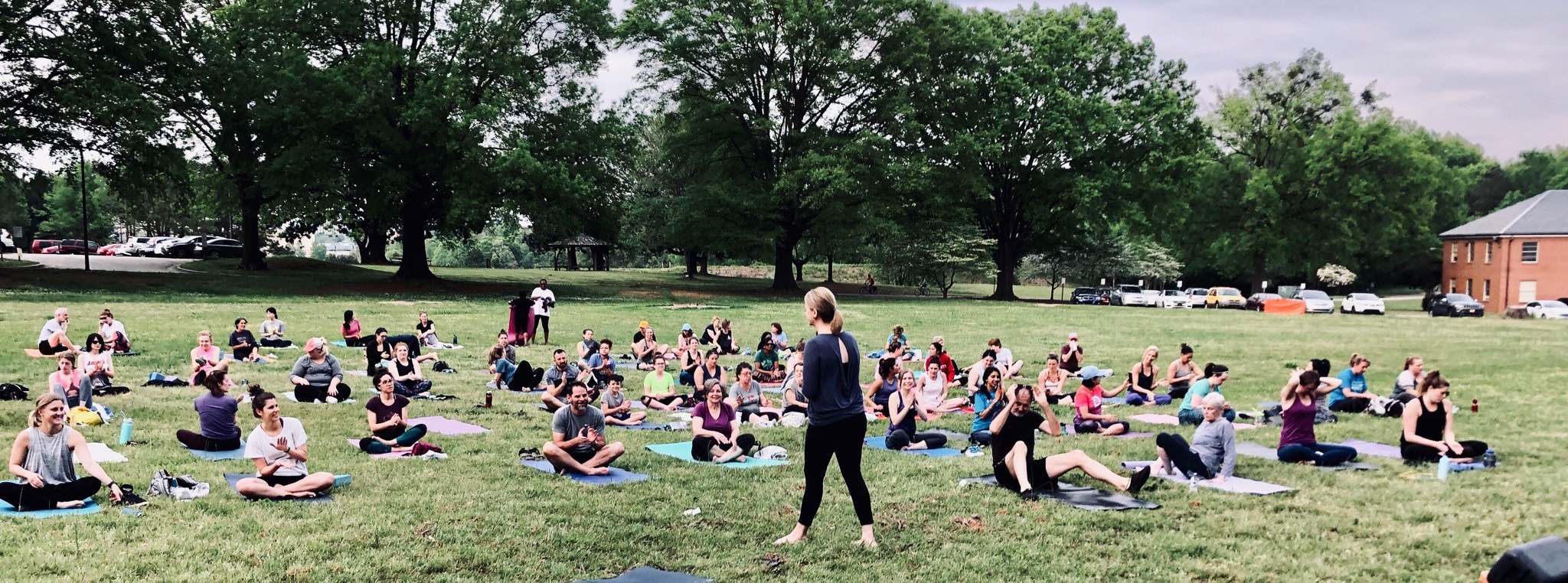 Yoga class outdoors at Dix Park